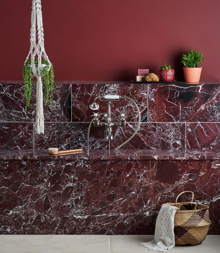 A striking, rich deep burgundy stone set through with a contrasting white vein creating the appearance of unmitigated luxury_